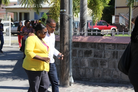 Senior and Junior Ministers of Health on Nevis Hon. Mark Brantley and Hon. Hazel Brandy-Williams conversing during the march through Charlestown in observance of World AIDS Day 2013