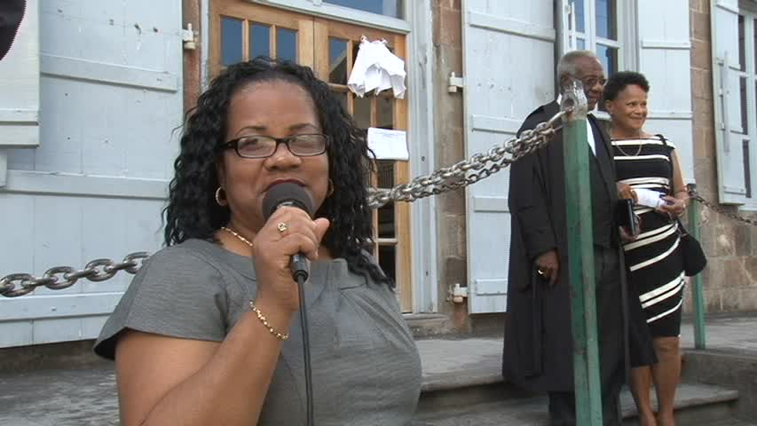 Mrs. Charmaine Hanley outside the High Court in Charlestown