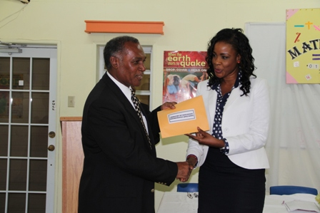 Premier of Nevis, Hon. Vance Amory receiving a check on behalf of the Department of Education from the Royal Bank of Canada (RBC) RBTT Representative Mrs. Corliss Sutton for sponsorship of the first Math Bowl Competition