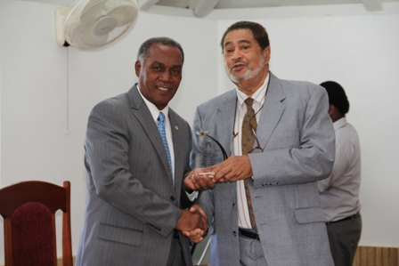 Premier of Nevis Hon. Vance Amory receiving a plaque from Deputy Governor General His Honour Eustace John from the Nevis Island Assembly as one of the longest serving parliamentarian at a special sitting of the Assembly on December 10, 2013 at the at its Chambers in Hamilton House