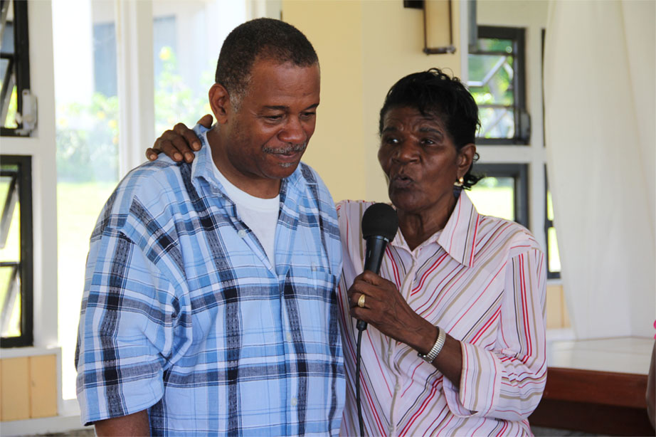 President of the Empire Sports Club Mr. Eric Evelyn gets an appreciative hug from one of the senior citizens of Hanleys Road following an island tour and luncheon at Mount Nevis Hotel on December 13, 2013
