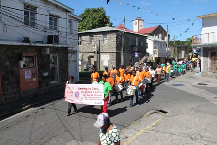 Government and Health officials on Nevis join students in a march through Charlestown in observance of World AIDS Day 2013
