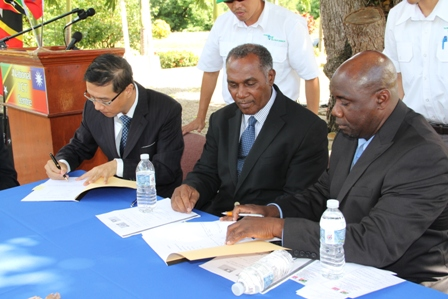 Documents signing by (extreme left) Republic of China/Taiwan's Resident Ambassador to the Federation His Excellency Miguel Li-Jey Tsao  and (extreme right) Minister of Agriculture on Nevis Hon. Alexis Jeffers while Premier of Nevis Hon. Vance Amory looks on, on December 06, 2013