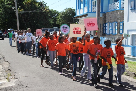 Students from schools on Nevis march in observance of World AIDS Day