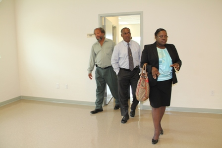 Premier of Nevis (middle), Hon. Hazel Brandy-Williams and Director of the Nevis Disaster Management Department Mr. Lester Blackette touring the state-of-the-art Emergency Operating Centre