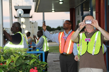 Deputy Premier and Minister of Tourism Hon. Mark Brantley (second from right) and others document a memorable moment when Seaborne Airlines touched down at the Vance W. Amory International Airport on January 15, 2014 for the first time