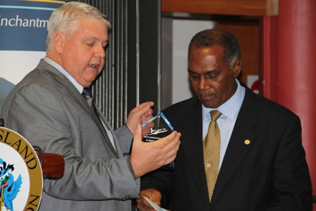 Director of Business Development at Seaborne Airlines Michael Ritzi presents a token to Premier of Nevis in commemoration of the Airline's inaugural flight to Nevis at a ceremony to mark the event at the Vance W. Amory International Airport on January 22, 2014