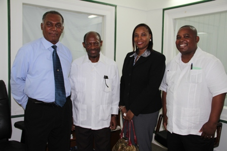 (L-R) Premier of Nevis Hon. Vance Amory, Prime Minister of St. Kitts and Nevis the Right Hon. Dr. Denzil Douglas, Financial Secretary Hilary Hazel and Comptroller of the St. Kitts and Nevis Inland Revenue Department Edward Gift