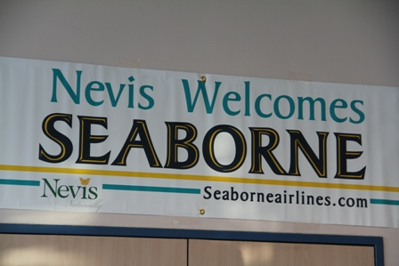 A hanging banner during ceremony at the Vance W. Amory International Airport on January 22, 2014, to commemorate the inaugural flight of Seaborne Airlines into Nevis on January 15, 2014, says it all
