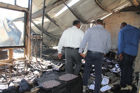 Members of Cabinet tour the gutted Treasury building which was razed by fire in the wee hours of January 17, 2014