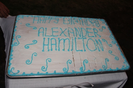 Inscription of the birthday cake in celebration of the birthday anniversary of Alexander Hamilton who was born in Nevis