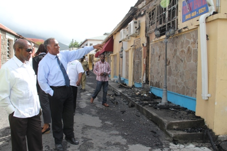 Prime Minister of St. Kitts and Nevis the Right Hon. Dr. Denzil Douglas (l) and Premier of Nevis Hon. Vance Amory (r) leaving Bath Hotel for a tour of the burnt Treasury Building in Charlestown at the end of a meeting on January 24, 2014. They are accompanied by Assistant Commissioner of Police attached to the Nevis Division Robert Liburd