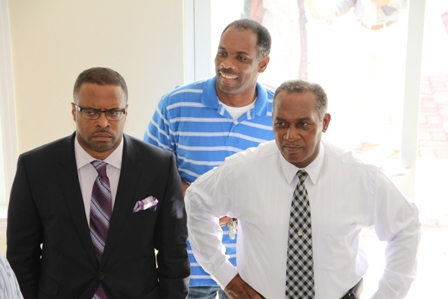 Premier of Nevis Hon. Vance Amory (right), Deputy Premier Hon. Mark Brantley (l) and Treasurer in the Nevis Island Administration Colin Dore (back) during a tour of the Nevis Corporative Credit Union's Ingle Blackette Building Business Complex in Charlestown along with other members of the NIA Cabinet