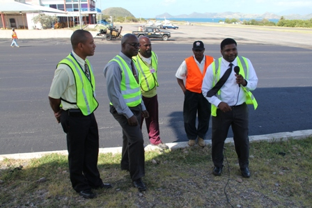 (L-R) Manager of the Vance W. International Airport Stephen Hanley, Permanent Secretary in the Ministry of Communication and Works Ernie Stapleton, Supervisors at the Public Works Department Danny Williams and Antonio Marshall and Junior Minister responsible for Communications and Works Hon. Troy Liburd at the Vance W. Amory International Airport on January 28, 2014