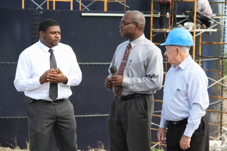 (L-R) Junior Minister responsible for Public Utilities Hon. Troy Liburd accompanied by Permanent Secretary Ernie Stapleton and Project Coordinator Brian Kennedy of the Caribbean Development Bank-funded Nevis Water Enhancement Project, visit Camps where the first reservoir is under construction