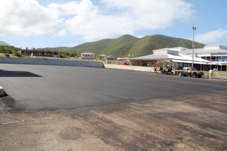Members of the Nevis Island Administration's Public Works Department overlaying a section of the Vance W. Amory International Airport's parking apron on January 28, 2014