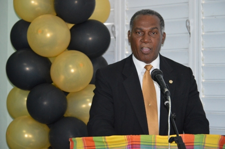 Premier of Nevis and Minister of Education Hon. Vance Amory delivering remarks at the unveiling ceremony for the Charlestown Secondary School Library and Media Centre's Hall of Fame on February 07, 2014