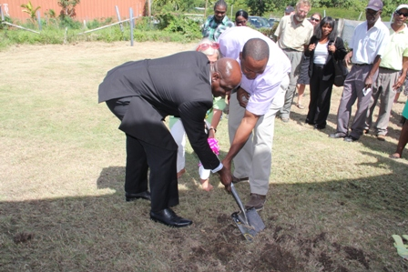 Minister of Agriculture Hon. Alexis Jeffers, Friends of ARK Member Mrs Bonnie Berlinghof and Dr. Ambrose James, one of two vets at the Ministry of Agriculture's Veterinary Service Department on Nevis, turning the sod to signal the start of the Veterinary Clinic Extension project at Prospect Estate on January 30, 2014