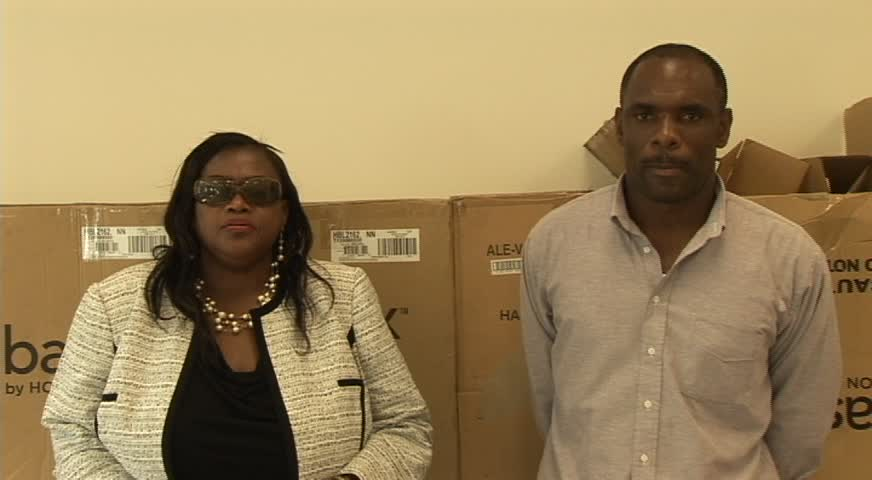 (L-R) Federal Central Purchasing Unit Representative Joycelyn Matthew-Martin and Treasurer in the Nevis Island Administration Colin Dore