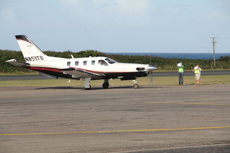 An aircraft of the 12-member group escorted to Nevis by Air Journey landing at the Vance W. Amory International Airport on January 30, 2014