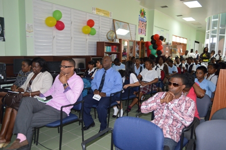 A section of persons present including Deputy Premier of Nevis Hon. Mark Brantley (third from right) at the unveiling of the Charlestown Secondary School Library and Media Centre's Hall of Fame on February 07, 2014