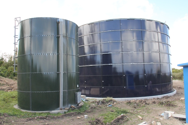 The completed water tank in the Caribbean Development Bank funded Water Enhancement Project, stands on the right of the existing water tank at Spring Hill. It is the second of six tanks to be erected.