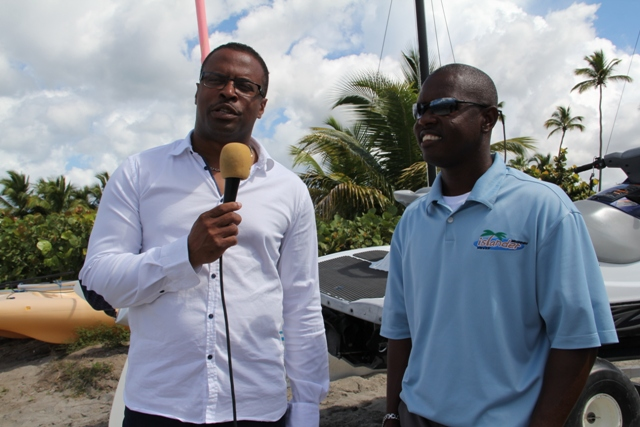 (L-R) Deputy Premier of Nevis and Minister of Tourism Hon. Mark Brantley speaks to proprietor of Islander Water Sports on Pinneys Beach Wincent Perkins during a field trip on March 04, 2014