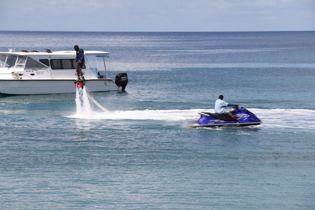 Certified staff of Islander Water Sports demonstrate Flyboarding the newest activity offered by the Nevisian-owned Company
