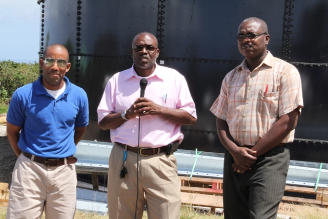 (l-r) Roger Hanley, Manager of the Nevis Water Department, Principal Assistant Secretary in the Ministry of Communication and Works Denzil Stanley with Permanent Secretary in the Ministry of Communication and Works Ernie Stapleton at Spring Hill where the second water tank is located