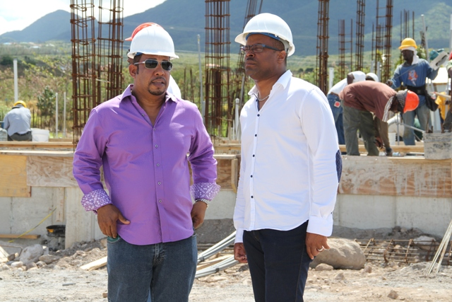 (L-R) Managing Director of the Residence at Tamarind Cove and Marina Project and local investor Greg Hardtman and Deputy Premier of Nevis and Minister of Tourism Hon. Mark Brantley touring the project site on March 04, 2014