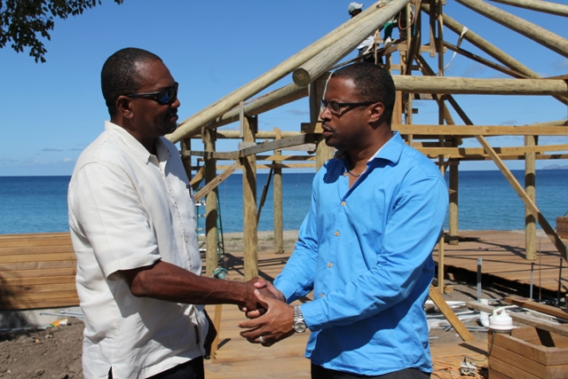 Deputy Premier of Nevis and Minister of Tourism Hon. Mark Brantley with General Manager of the Paradise Beach Nevis Ltd. Laughton Grant, in front of ongoing construction of the Beach Bar at Paradise Beach Nevis Ltd at Colquhoun Estate on March 04, 2014