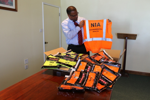 Hon. Mark Brantley displays one of 50 reflective vests he donated to the Ministry of Health on March 24, 2014 at the conference room of the Alexandra Hospital's Administration Building