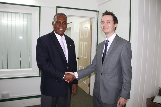 (L-R) Premier of Nevis Hon. Vance Amory at his Bath Plain Office with Martin Robinson, Head of Politics, Press and Public Affairs at the British High Commission in Bridgetown, Barbados on April 30, 2014