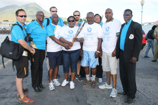Ministers Hon. Alexis Jeffers and Hon. Hazel Brandy-Williams along with Cabinet Secretary Steadmond Tross and President of the Nevis Island Assembly Farrell Smithen along with a contingent from Scotland participate in the Nevis leg of the Queen's Baton Relay