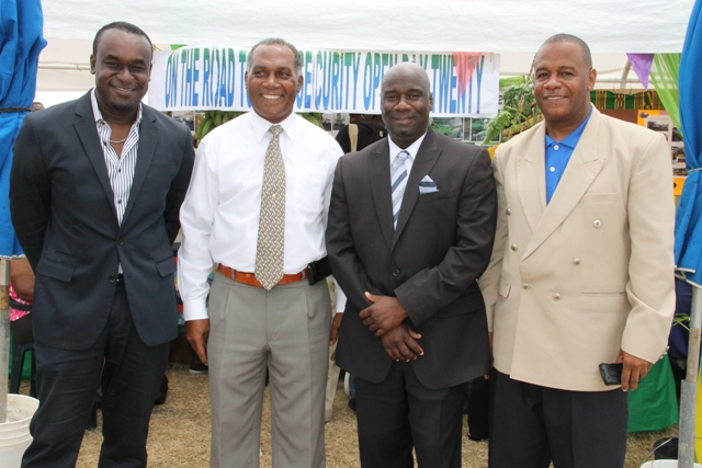 (l-r) Chairman and CEO of TEMPO Networks, LLC Frederick Morton Jr., Premier of Nevis Hon. Vance Amory, Minister of Agriculture Hon. Alexis Jeffers and Permanent Secretary in the Department of Agriculture Eric Evelyn visiting booths at the 20th Annual Agriculture Open Day
