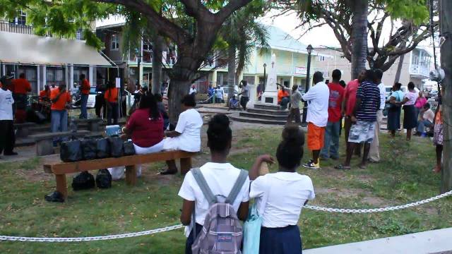 Part of an appreciative audience listen to the Rehabilitation Group Impression (RGI), a two-year-old band from Her Majesty's Prison in Basseterre performing live as part of the Ministry of Social Development's Youth Month 2014 activities