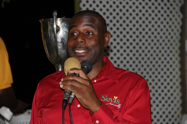 Devon Liburd Sales and Marketing Manager at the Nevis Tourism Authority delivering remarks at a cocktail reception at the Lime Beach Bar and Grill at Pinneys Beach, hosted by the Authority and the Nevis Air and Sea Ports Authority