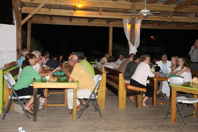 A section of persons at a cocktail reception at the Lime Beach Bar and Grill at Pinneys Beach Bar and Grill at Pinneys Beach, hosted by the Nevis Tourism Authority and the Nevis Air and Sea Ports Authority
