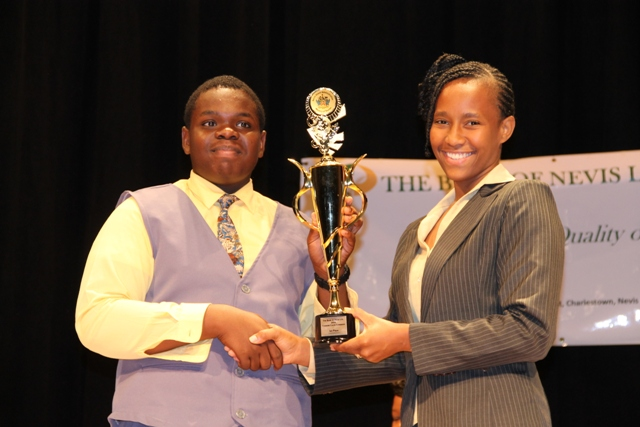 (l-r) First place winner of the 2014 Bank of Nevis Ltd. Tourism Youth Congress Rol-J Williams receives trophy from Bank of Nevis Marketing Officer Bronte Swanston-Hendrickson