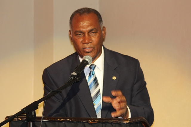 Premier of Nevis and Minister of Education Hon. Vance Amory delivering remarks at the Bank of Nevis Ltd. Tourism Youth Congress on May 08, 2014 at the Nevis Performing Arts Centre.