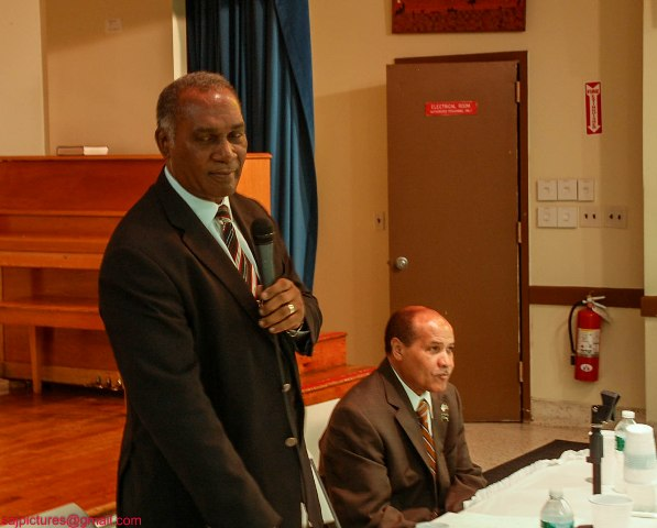 Premier of Nevis Hon. Vance Amory addressing Nevisians at the St. Luke's Episcopal Church in the Bronx, New York on May 23, 2014 with Mr. Edmund Sadio a successful Nevisian businessman seated.