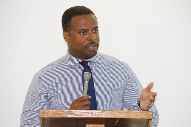 Deputy Premier and Minister of Tourism in the Nevis Island Administration Hon. Mark Brantley delivering remarks at the first phase of the Hospitality Assured programme at the Oualie Beach Resort conference room on May 12, 2014, jointly sponsored by the Caribbean Tourism Organization, the Organization of American States and the Nevis Island Administration