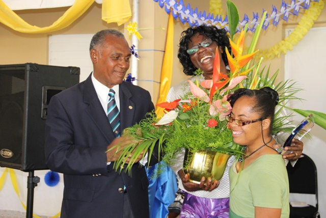 Special Education pioneer on Nevis Reverend Cecele Thompson-Browne is acknowledged by Hazel Byron, a former student of the Special Education Unit at the renaming ceremony of the school in her honour on April 29, 2014. Premier of Nevis and Minister of Education Hon. Vance Amory looks on