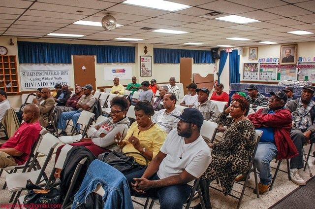 A section of Nevisians and other nationals of St. Kitts and Nevis listen to Premier of Nevis Hon. Vance Amory during a meeting at the St. Luke's Episcopal Church in the Bronx, New York on May 23, 2014