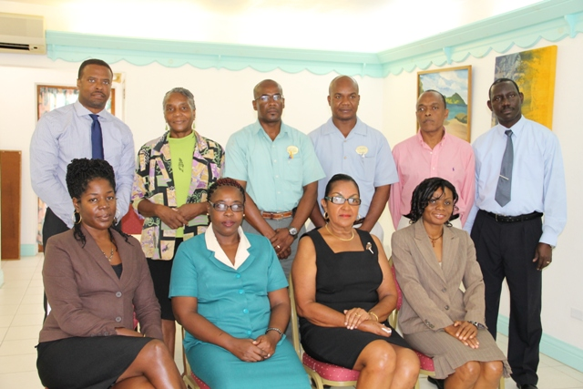 (Standing) Deputy Premier and Minister of Tourism in the Nevis Island Administration Hon. Mark Brantley, (second from left) Business Consultant from St. Kitts Euphemia Bryce-Roberts (extreme right), Hospitality Assured Programme facilitator Hugh Wint (second from right) and Policy and Regulations Officer in the Ministry of Tourism and Hospitality Assured Coordinator on Nevis John Hanley (extreme right). Seated (extreme left) Project Development Officer in the Ministry of Tourism Amelia Chiverton and (extreme right) Tourism Education Officer Vanessa Webbe with representatives of the Nisbet Plantation Beach Club, Oualie Beach Resort and Nelson Spring Beach Resort