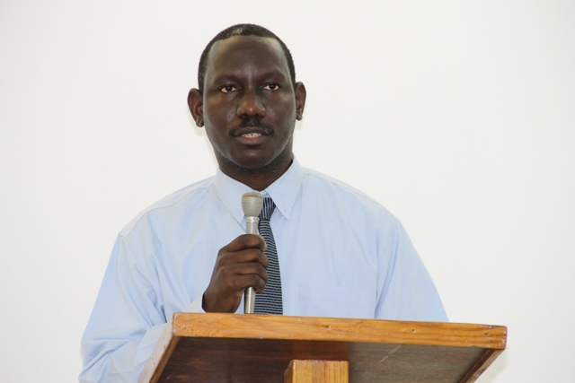 Policy and Regulations Officer in the Ministry of Tourism and Hospitality Assured Coordinator on Nevis John Hanley delivering remarks at the first phase of the Hospitality Assured programme at the Oualie Beach Resort conference room on May 12, 2014, jointly sponsored by the Caribbean Tourism Organization, the Organization of American States and the Nevis Island Administration