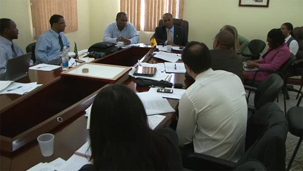 Premier of Nevis and Minister of Finance Hon Vance Amory and Acting Permanent Secretary in the Ministry of Finance Mr. Colin Dore (head table) meet with International Monetary Fund delegation at the Ministry of Finance conference room on May 13, 2014
