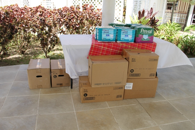 Some of the Nevis Association of South Florida's donation of 107 boxes of adult protective underwear to the Flamboyant Nursing Home on May 19, 2014
