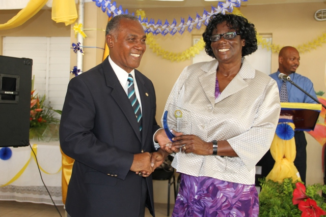 Premier of Nevis and Minister of Education in the Nevis Island Administration Hon. Vance Amory presents a plaque on behalf of the Special Education Unit to Reverend Cecele Thompson-Browne in recognition of her contribution to Special Education on Nevis at a re naming ceremony of the school in her honour on April 29, 2014