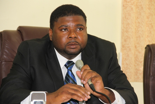 Junior Minister in the Ministry of Communication, Works and Public Utilities in the Nevis Island Administration Hon. Troy Liburd at the Ministry of Finance conference room on June 24, 2014